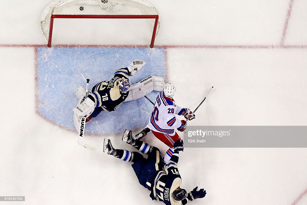 Chris Kreider #20 of the New York Rangers beats Joonas Korpisalo #70 of the Columbus Blue Jackets for a goal during the first period on April 4, 2016 at Nationwide Arena in Columbus, Ohio. New York defeated Columbus 4-2.