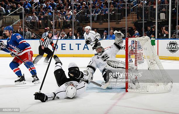 Chris Kreider of the New York Rangers called for interference on Drew Doughty of the Los Angeles Kings as goaltender Jonathan Quick falls to the ice...