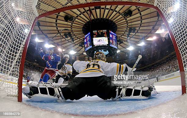 Chris Kreider of the New York Rangers celebrates after he scored the gamewinning goal in overtime against Dougie Hamilton and goalie Tuukka Rask of...
