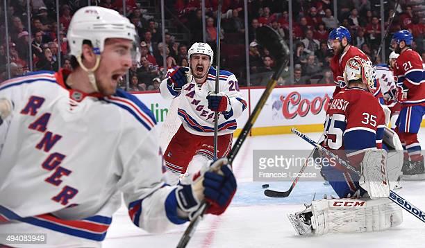 Chris Kreider of the New York Rangers celebrates after scoring a goal on goaltender Dustin Tokarski of the Montreal Canadiens in Game Five of the...