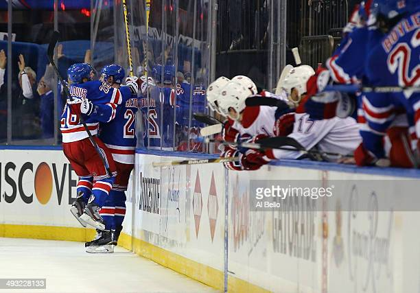 Chris Kreider of the New York Rangers celebrates his goal with Martin St Louis late in the third period against the Montreal Canadiens in Game Three...