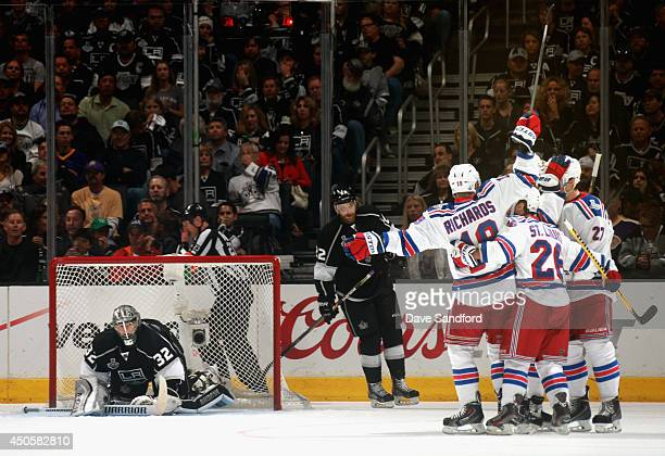 Chris Kreider of the New York Rangers celebrates his second period goal against goaltender Jonathan Quick of the Los Angeles Kings with teammates...