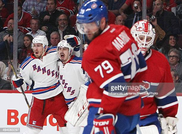 Chris Kreider of the New York Rangers celebrates his second period goal at 14:12 against the Montreal Canadiens during Game Five of the Eastern...