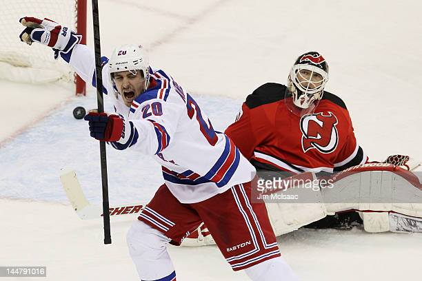 Chris Kreider of the New York Rangers celebrates his third period goal as Martin Brodeur of the New Jersey Devils reacts in Game Three of the Eastern...