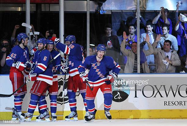 Chris Kreider of the New York Rangers celebrates his third period goal with teammates in Game One of the Eastern Conference Final against the New...