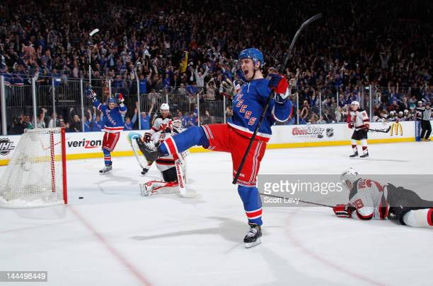 Chris Kreider of the New York Rangers celebrates his third period goal against Martin Brodeur of the New Jersey Devils in Game One of the Eastern...