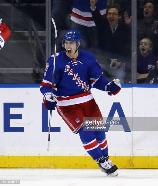 Chris Kreider of the New York Rangers celebrates the game wiining goal by Mats Zuccarello against the Washington Capitals at Madison Square Garden on...