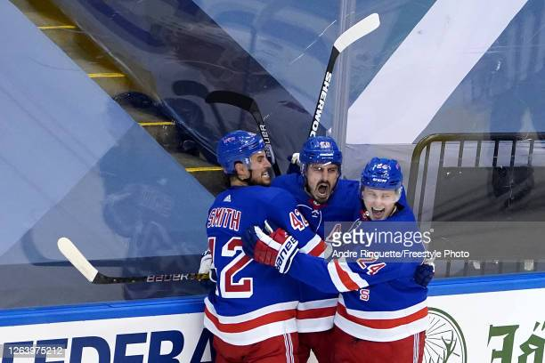 Chris Kreider of the New York Rangers celebrates with his teammates after scoring a goal on James Reimer of the Carolina Hurricanes during the second...