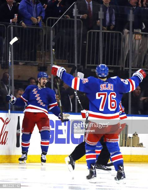 Chris Kreider of the New York Rangers celebrates with his teammates Brendan Smith and Brady Skjei after scoring a goal against Craig Anderson of the...