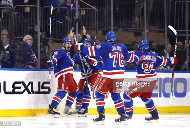 Chris Kreider of the New York Rangers celebrates with his teammates Brendan Smith Brady Skjei and Mika Zibanejad after scoring a goal against Craig...