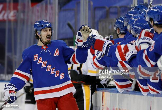 Chris Kreider of the New York Rangers celebrates with teammates after scoring a goal during the third period against the Pittsburgh Penguins at...