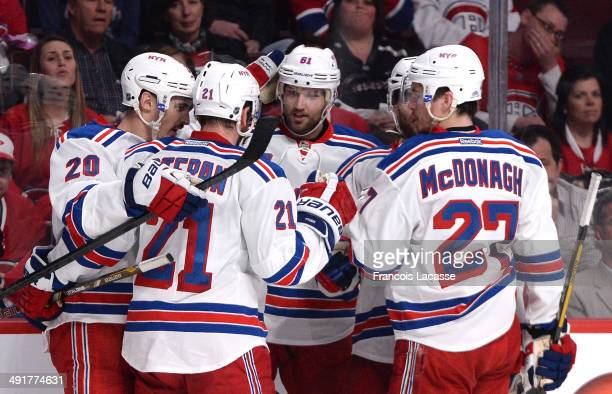Chris Kreider of the New York Rangers celebrates with teammates Derek Stepan Rick Nash and Ryan McDonagh after scoring a goal against the Montreal...