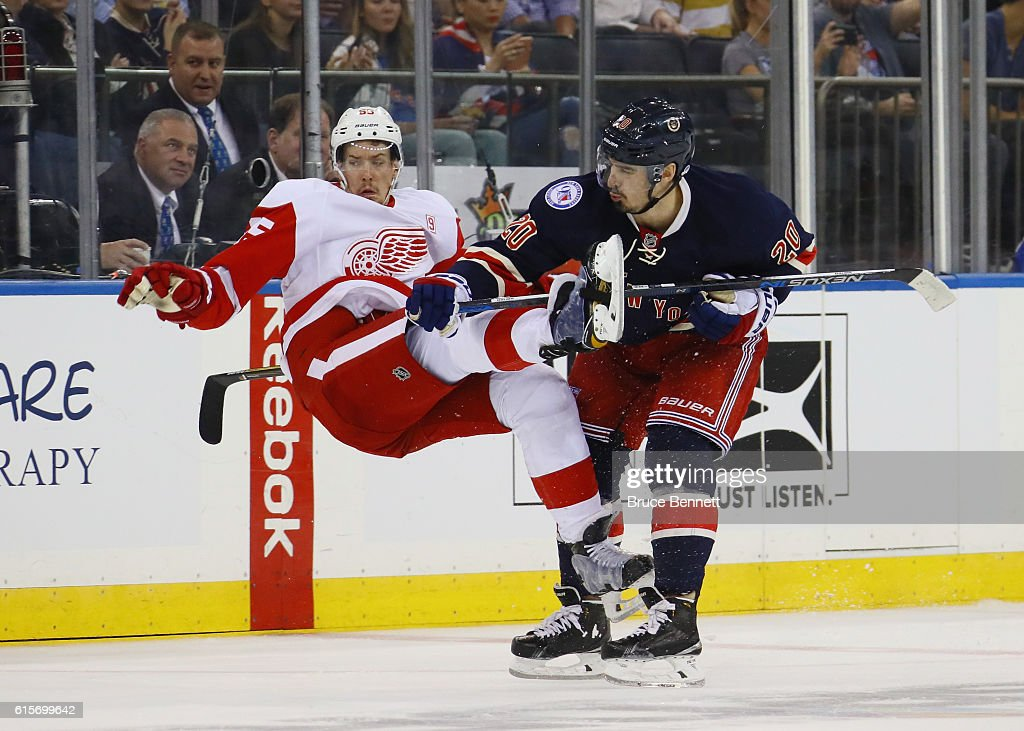 Chris Kreider #20 of the New York Rangers checks Danny DeKeyser #65 of the Detroit Red Wings during the second period at Madison Square Garden on October 19, 2016 in New York City.