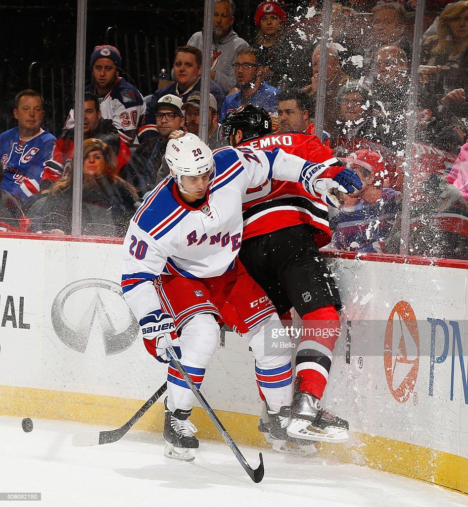 2f7f7345f Chris Kreider of the New York Rangers checks David Schlemko of the ...