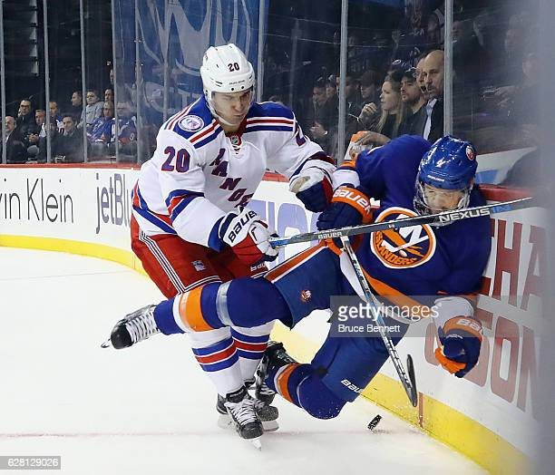 Chris Kreider of the New York Rangers checks Dennis Seidenberg of the New York Islanders into the boards during the third period at the Barclays...