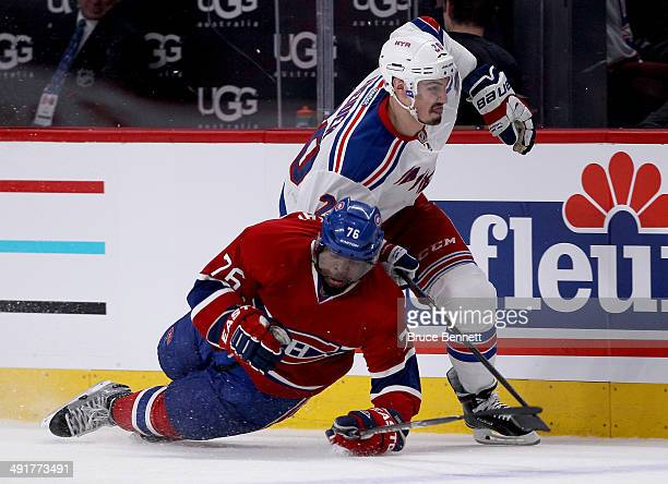 Chris Kreider of the New York Rangers checks PK Subban of the Montreal Canadiens in the second period in Game One of the Eastern Conference Finals of...