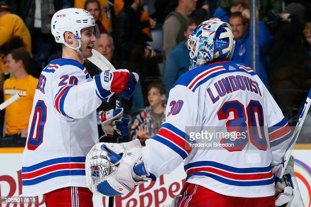 Chris Kreider of the New York Rangers congratulates teammate Henrik Lundqvist after a 43 victory over the Nashville Predators at Bridgestone Arena on...