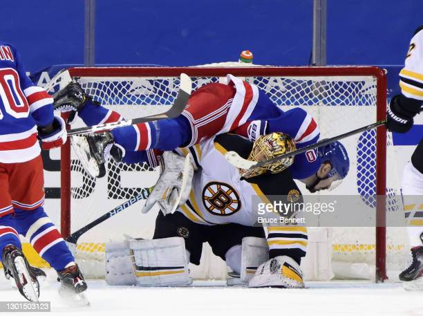 Chris Kreider of the New York Rangers falls over Tuukka Rask of the Boston Bruins during the third period at Madison Square Garden on February 10,...