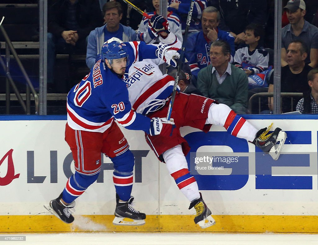 Chris Kreider #20 of the New York Rangers hots Alex Ovechkin #8 of the Washington Capitals into the boards during the first period in Game Two of the Eastern Conference Semifinals during the 2015 NHL Stanley Cup Playoffs at Madison Square Garden on May 2, 2015 in New York City.