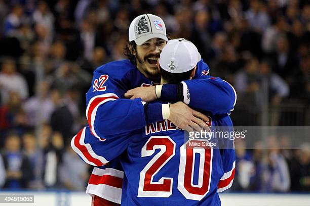 Chris Kreider of the New York Rangers hugs teammate Brian Boyle after defeating the Montreal Canadiens in Game Six to win the Eastern Conference...