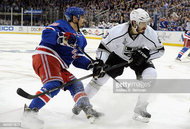 Chris Kreider of the New York Rangers pressures Drew Doughty of the Los Angeles Kings during the second period of Game Three of the 2014 Stanley Cup...