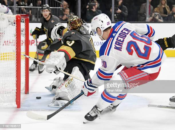 Chris Kreider of the New York Rangers scores a first-period goal against Malcolm Subban of the Vegas Golden Knights during their game at T-Mobile...
