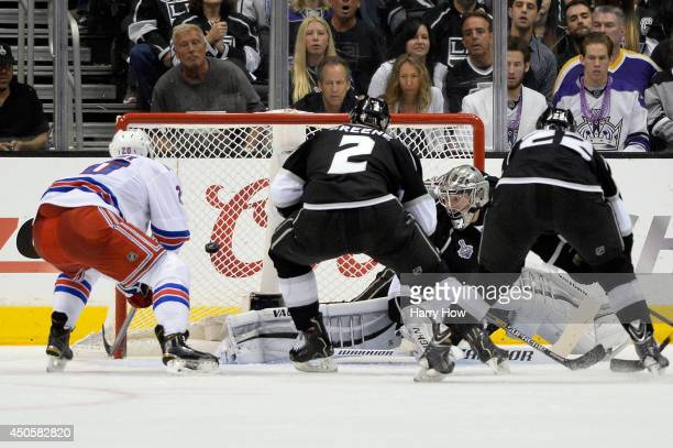 Chris Kreider of the New York Rangers scores a second period goal past goaltender Jonathan Quick of the Los Angeles Kings during Game Five of the...