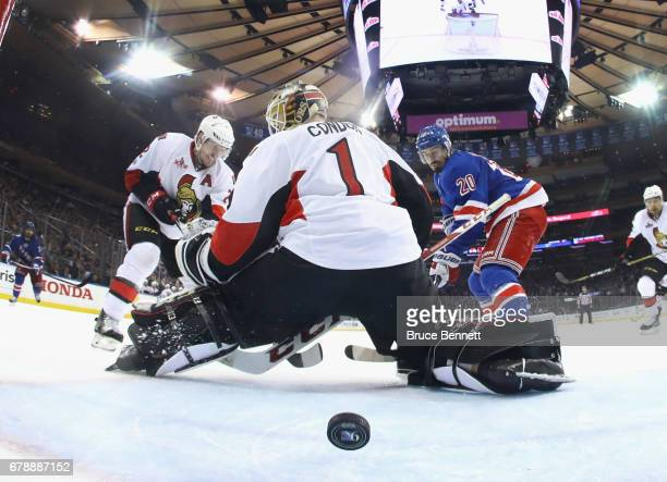 Chris Kreider of the New York Rangers scores a third period goal against Mike Condon of the Ottawa Senators in Game Four of the Eastern Conference...