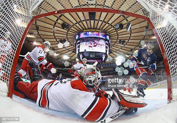 Chris Kreider of the New York Rangers scores at 1711 of the third period against Michael Leighton of the Carolina Hurricanes Carolina Hurricanes at...