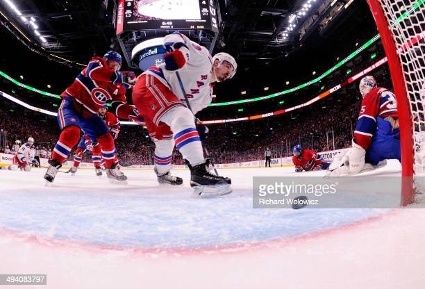 Chris Kreider of the New York Rangers shoots the puck into the net for a second period goal at 1412 against the Montreal Canadiens during Game Five...