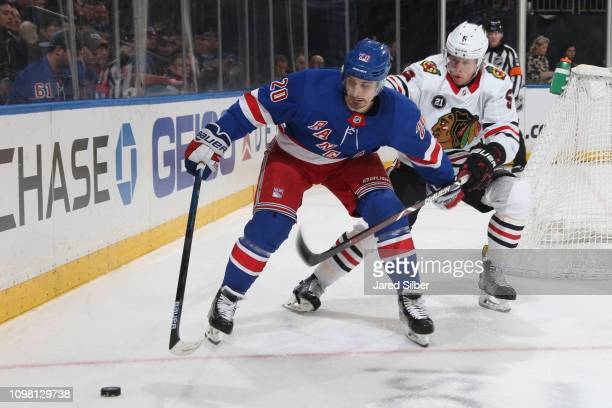Chris Kreider of the New York Rangers skates with the puck against Connor Murphy of the Chicago Blackhawks at Madison Square Garden on January 17...