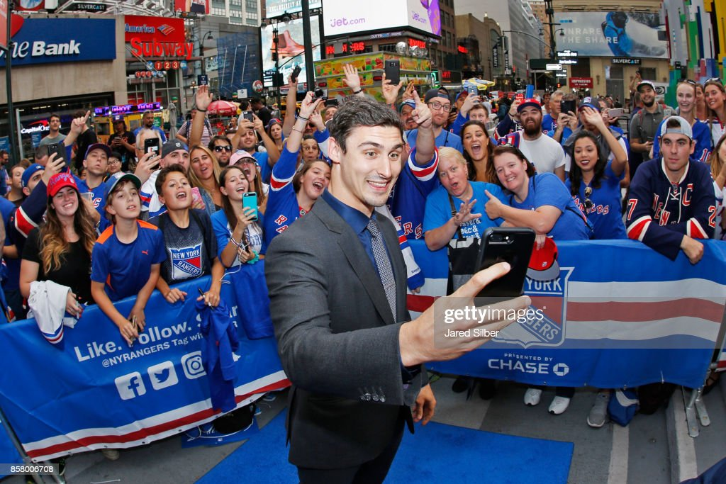Chris Kreider of the New York Rangers takes a photo with fans as he walks the Blue Carpet prior to the home opener against the Colorado Avalanche at Madison Square Garden on October 5, 2017 in New York City.