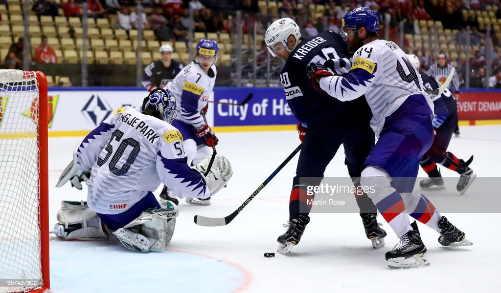 Chris Kreider #20 of United States fails to socre over Sungje Park, goaltender of Korea battle for the puck during the 2018 IIHF Ice Hockey World Championship group stage game between United States and Korea at Jyske Bank Boxen on May 11, 2018 in Herning, Denmark.