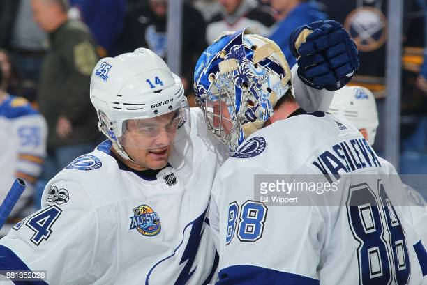 Chris Kunitz and Andrei Vasilevskiy of the Tampa Bay Lightning celebrate after an NHL game against the Buffalo Sabres on November 28 2017 at KeyBank...