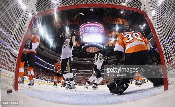 Chris Kunitz and Evgeni Malkin of the Pittsburgh Penguins celebrate a powerplay goal by Kris Letang against the Philadelphia Flyers in Game Four of...