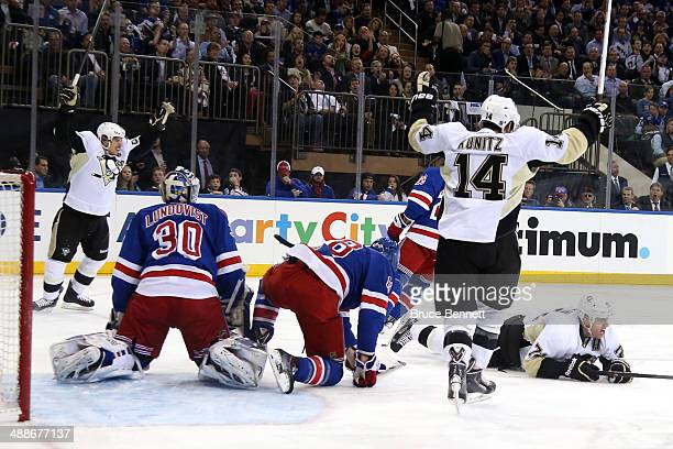 Chris Kunitz and Sidney Crosby celebrate after Evgeni Malkin of the Pittsburgh Penguins scores a goal in the first period against Henrik Lundqvist of...