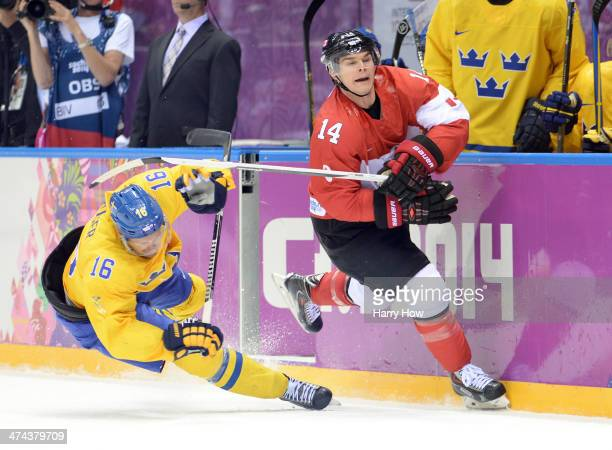 Chris Kunitz of Canada high sticks Marcus Kruger of Sweden during the Men's Ice Hockey Gold Medal match on Day 16 of the 2014 Sochi Winter Olympics...