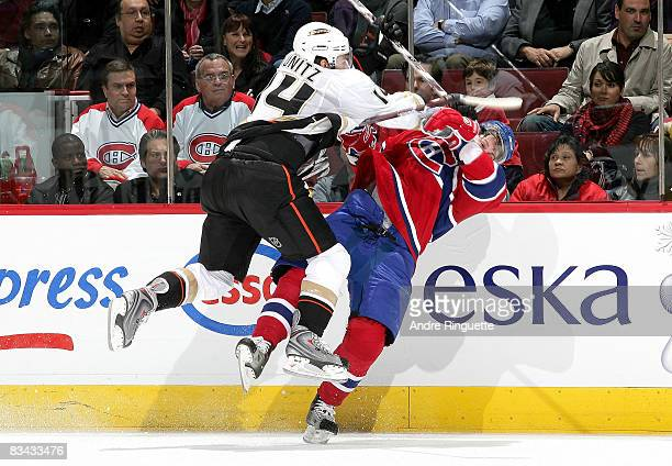 Chris Kunitz of the Anaheim Ducks hits Sergei Kostitsyn of the Montreal Canadiens and is called for a penalty at the Bell Centre on October 25 2008...