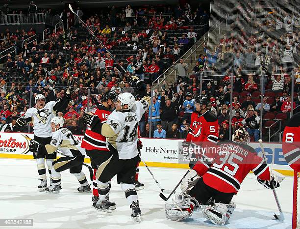 Chris Kunitz of the Pittsburgh Penguins celebrates scoring a goal on Cory Schneider of the New Jersey Devils during the third period at the...