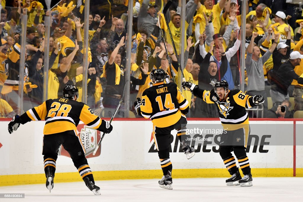 Chris Kunitz #14 of the Pittsburgh Penguins celebrates with Sidney Crosby #87 and Ian Cole #28 after scoring a goal against Craig Anderson #41 of the Ottawa Senators in the second overtime with a score of 3 to 2 in Game Seven of the Eastern Conference Final during the 2017 NHL Stanley Cup Playoffs at PPG PAINTS Arena on May 25, 2017 in Pittsburgh, Pennsylvania.