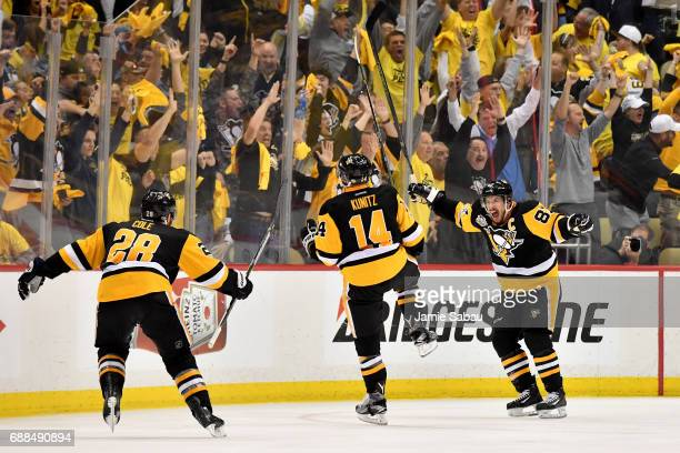 Chris Kunitz of the Pittsburgh Penguins celebrates with Sidney Crosby and Ian Cole after scoring a goal against Craig Anderson of the Ottawa Senators...