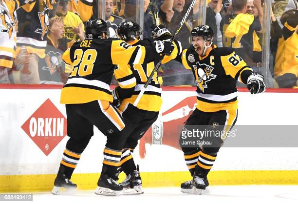 Chris Kunitz of the Pittsburgh Penguins celebrates with Sidney Crosby and Ian Cole after scoring a goal agianst Craig Anderson of the Ottawa Senators...