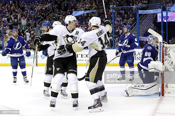 Chris Kunitz of the Pittsburgh Penguins celebrates with teammate Evgeni Malkin after scoring a goal against Andrei Vasilevskiy of the Tampa Bay...