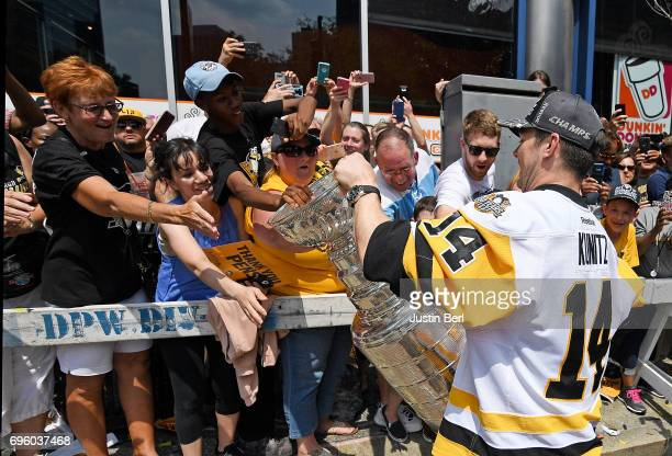 Chris Kunitz of the Pittsburgh Penguins holds the Stanley Cup for fans to touch during the Victory Parade and Rally on June 14 2017 in Pittsburgh...