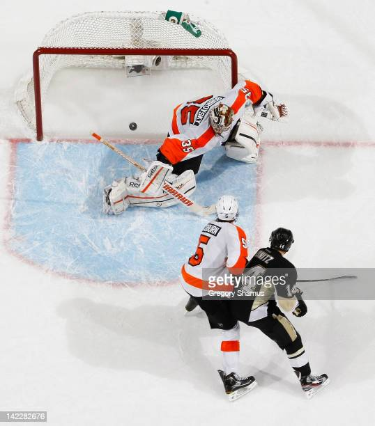 Chris Kunitz of the Pittsburgh Penguins scores a goal on Sergei Bobrovsky of the Philadelphia Flyers in front of Braydon Coburn on April 1 2012 at...