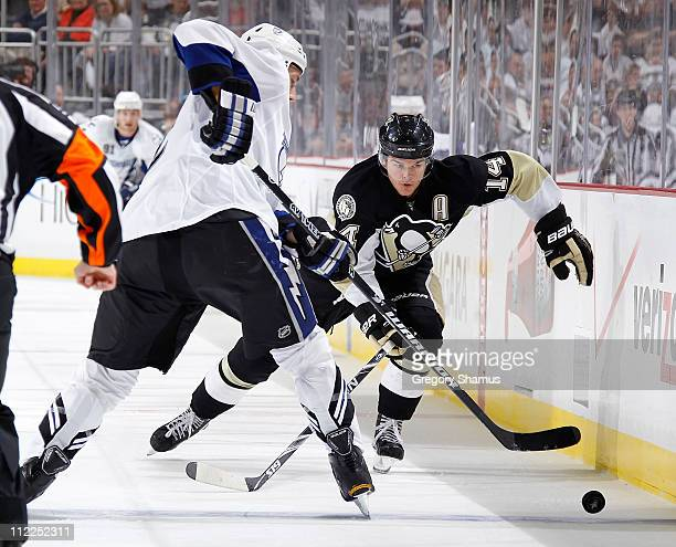 Chris Kunitz of the Pittsburgh Penguins skates for the loose puck against the Tampa Bay Lightning in Game Two of the Eastern Conference Quarterfinals...