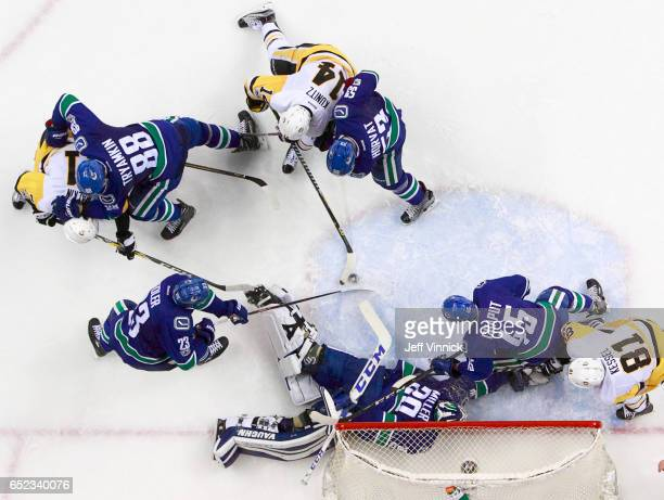 Chris Kunitz of the Pittsburgh Penguins takes a shot against Ryan Miller of the Vancouver Canucks during their NHL game at Rogers Arena March 11,...