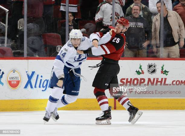Chris Kunitz of the Tampa Bay Lightning and Nick Cousins of the Arizona Coyotes tangle during the third period at Gila River Arena on December 14...