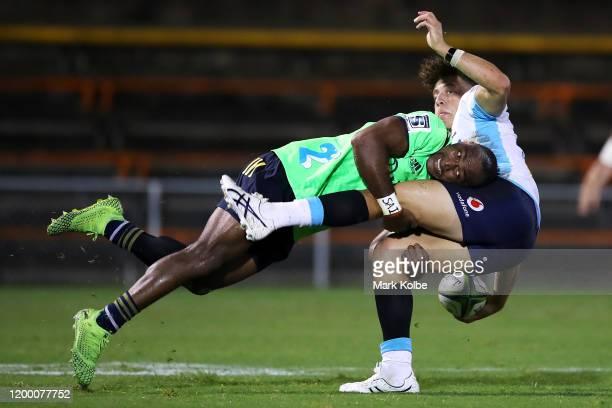 Chris Kuridrani of the Highlanders tackles Mark Nawaqanitawaseof the Waratahs during the pre-season Super Rugby match between the Waratahs and the...