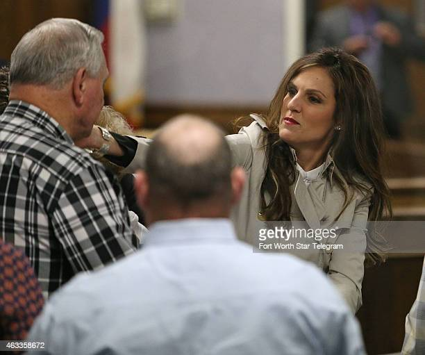 Chris Kyle's widow Taya Kyle hugs supporters before court is in session during the capital murder trial of former Marine Cpl Eddie Ray Routh at the...